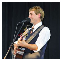 Kirby Heyborne in concert. Having a laugh with the audience.
